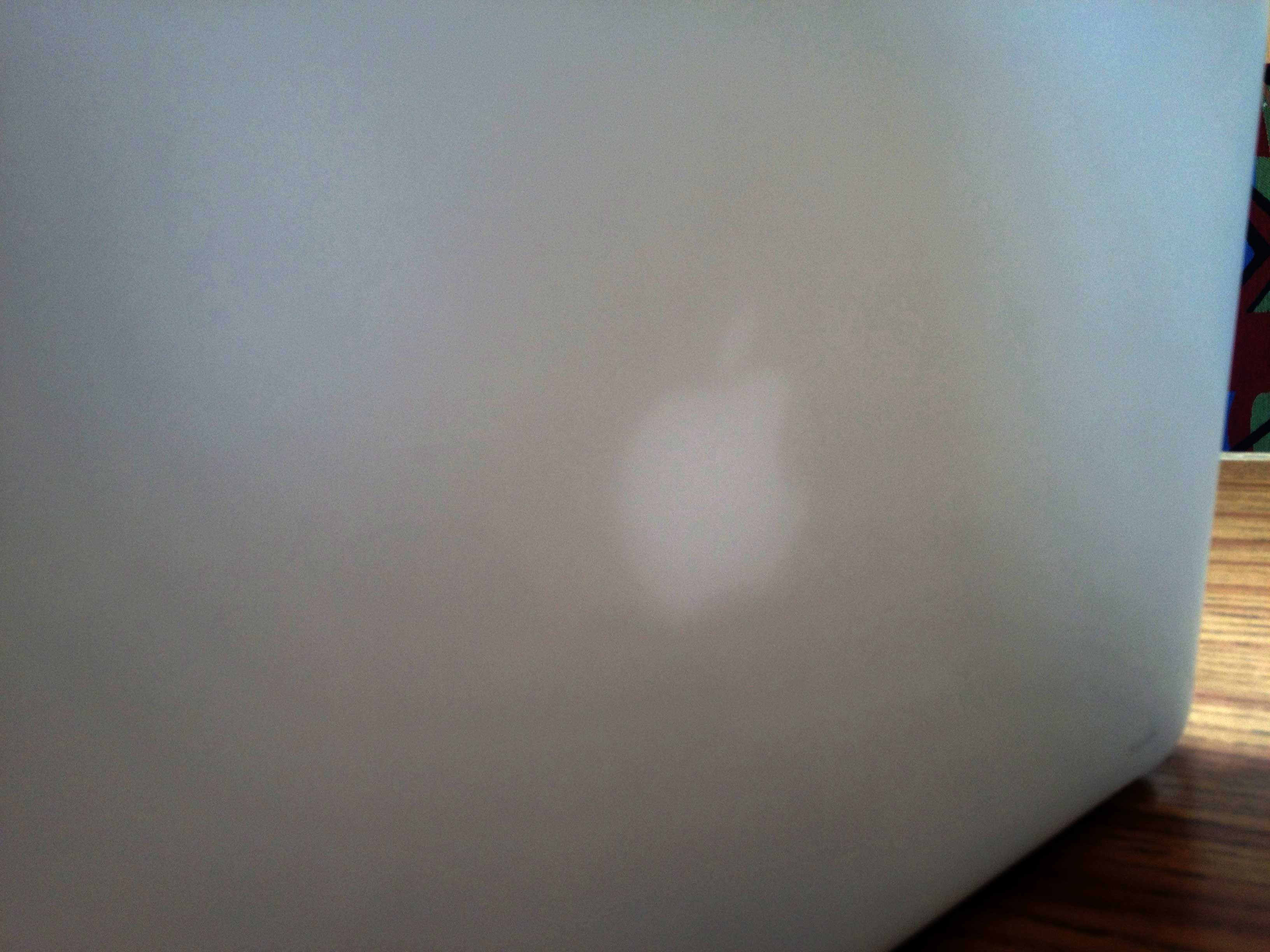 Apple Logo glowing through iGlaze