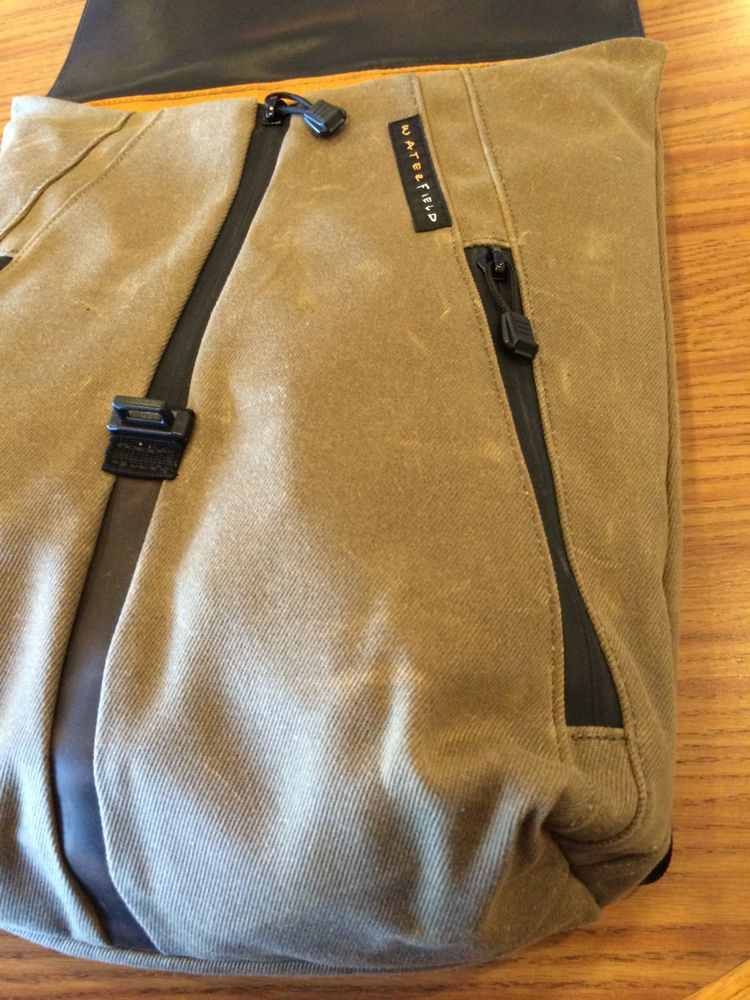 staad backpack outside pocket zipped up